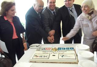 U.S. Tunisia participants cut cake at SME graduation